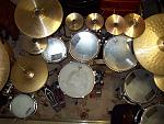"Ludwig Classic Maple 8x6"", 10x8"", 12x8"" rack toms, Rogers 13x9"" and 14x10"" toms (as floor toms), Rogers 20x14"" bass drum (or Pearl/Maxwin 18x12"" bass drum), various snares. Paiste, Wuhan and UFIP cymbals. DW pedals and hi-hat, Tama, Ludwig, Pearl, Gibraltar and miscellaneous hardware."